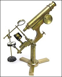 American made microscope on a double pillar and rotating base. Most likely made by an amateur, c. 1885
