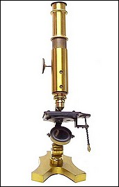 Small French microscope with lever stage mechanism.