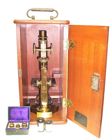 Schrauer, Maker, New York. Continental style monocular microscope stored in the case