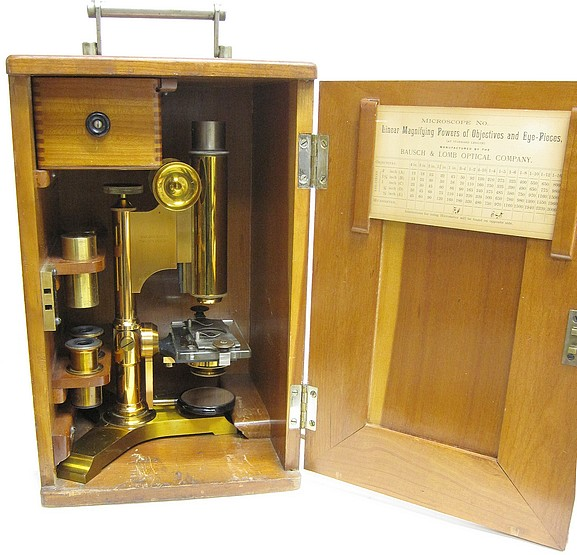 bausch & lomb optical co., serial no. 7516. an uncommon variant of the physician's model microscope with a tripod base, c. 1889. in the storage case