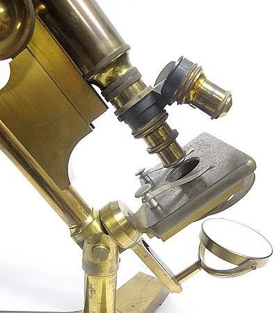 JNO EHRMANN, Maker, 1905. Monocular microscope on a tripod basef