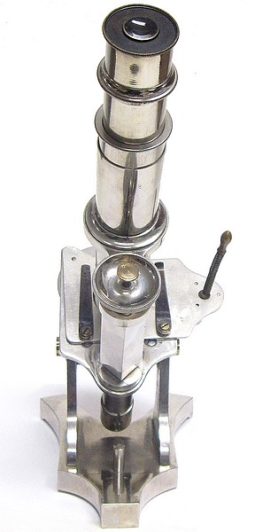 French microscope with lever controlled stage. Nickel plated