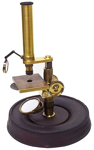 J & W Grunow, New York, serial number 267. Small microscope on a round iron and wood base. c. 1864