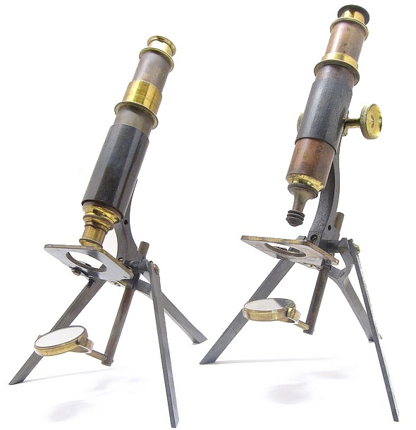 Two version of the Queen Tourist portable microscope