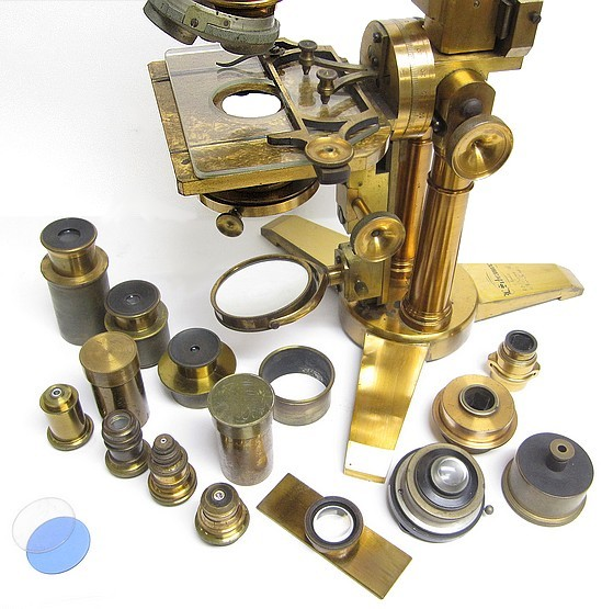 l. schrauer, maker, 42 nassau st., new york. large microscope on a double pillar with swinging substage, c. 1880