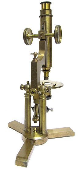 American made microscope on a double pillar and rotating base